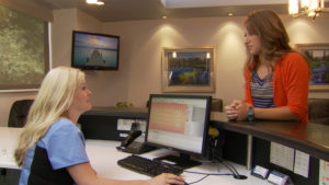 Receptionist and patient talking